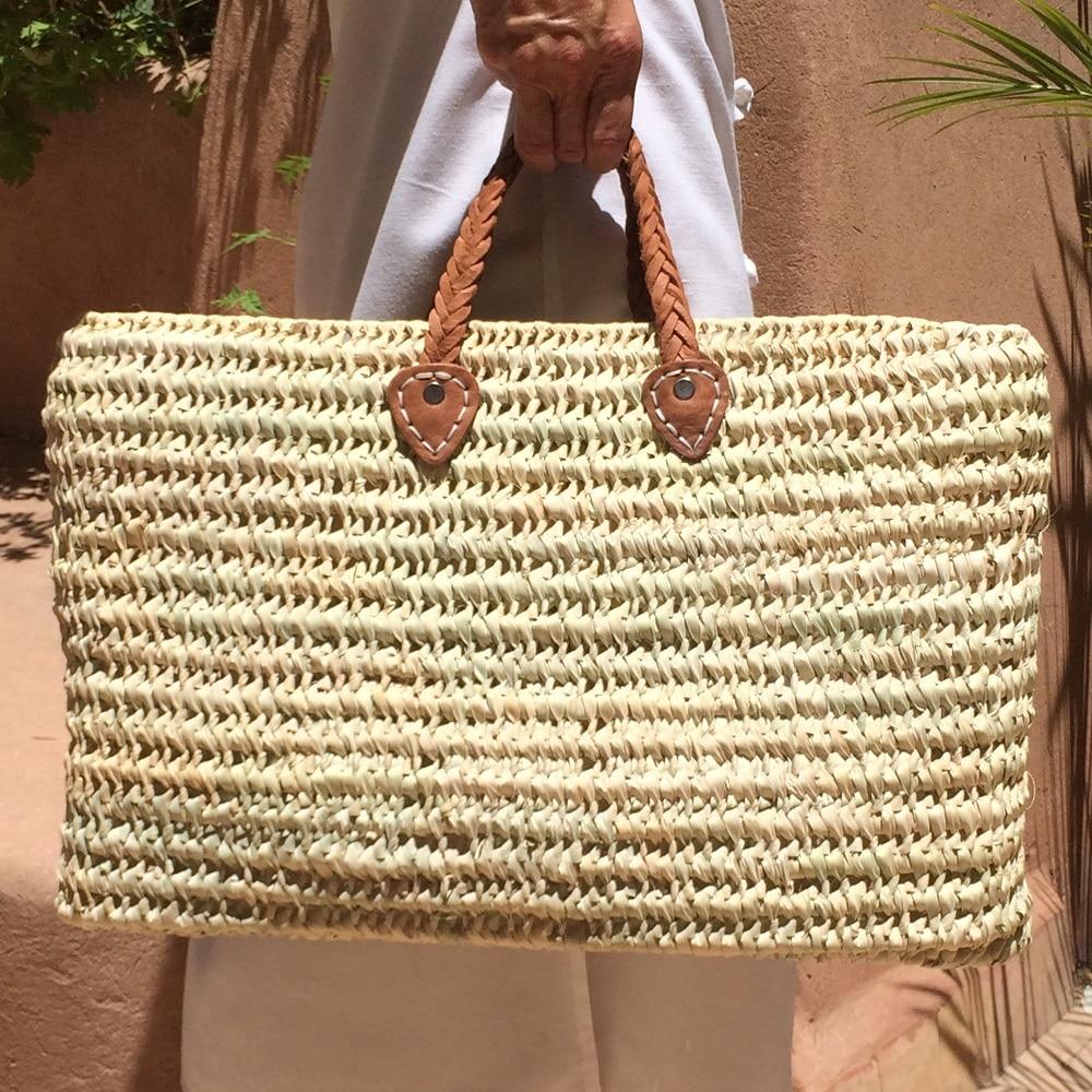 panier de plage pour l'été en feuilles de palmier et cuir fait à la main marque flo and jouls flo&jouls