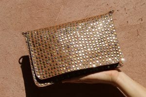 Women handbag bag handmade in leather and suede handmade by our artisans in Morocco with rock studding brand flo and jouls